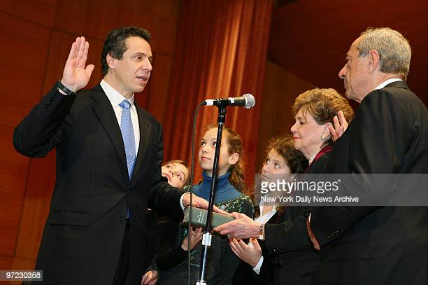 Andrew Cuomo is sworn in as the 64th State Attorney General as daughters Michaela Mariah and Cara mother Matilda and father former Gov Mario Cuomo...
