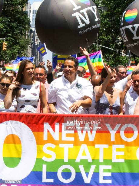 Andrew Cuomo with his daughters Michaela Cuomo Mariah Cuomo and Cara Cuomo are seen at the World Pride NYC on June 30 2019 in New York City