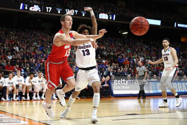 Andrew Dakich of the Ohio State Buckeyes passes the ball against Josh Perkins of the Gonzaga Bulldogs during the first half in the second round of...