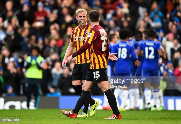 Andrew Davies of Bradford City and Andrew Halliday of Bradford City exchange words after Ramires of Chelsea scored his team's second goal during the...