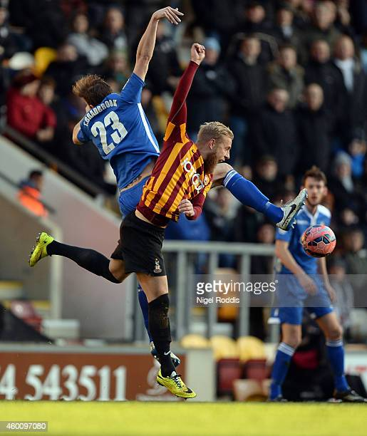 Andrew Davies of Bradford City challenges Tom Bradbrook of Dartford during the FA Cup Second Round football match between Bradford City and Dartford...