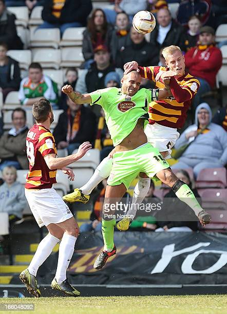 Andrew Davies of Bradford City contests the ball with Clarke Carlisle of Northampton Town during the npower League Two match between Bradford City...