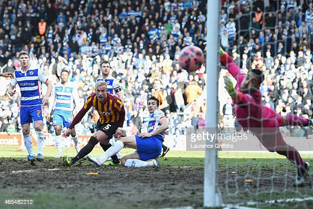 Andrew Davies of Bradford City heads the ball wide of the Reading goal during the FA Cup Quarter Final match between Bradford City and Reading at the...
