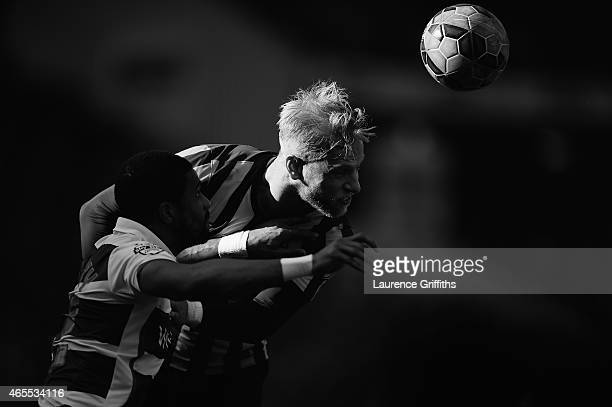 Andrew Davies of Bradford City rises for the ball during the FA Cup Quarter Final betweeen Braford City and Reading at Coral Windows Stadium Valley...