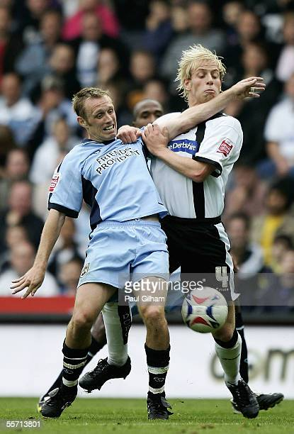Andrew Davies of Derby County battles for the ball with Brett Ormerod of Southampton during the CocaCola Championship match between Derby County and...