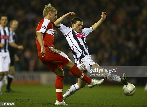 Andrew Davies of Middlesbrough battles for the ball with Jason Koumas of West Bromwich Albion during the FA Cup sponsored by EON 5th Round Replay...