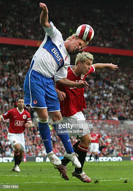 Andrew Davies of Middlesbrough wins the ball in the air from Alan Smith of Manchester United during the Barclays Premiership match between Manchester...