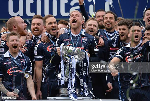 Andrew Davies of Ross County lifts the League Cup Trophy as his side beet Hibernian 2-1 during the Scottish League Cup Final between Hibernian FC and...
