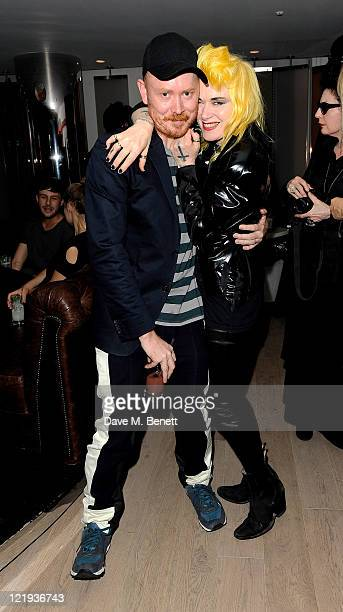 Andrew Davis and Pam Hogg attend the launch of designer Gareth Pugh's limited edition ABSOLUT MODE bottle in the EWOW Suite at W London Leicester...