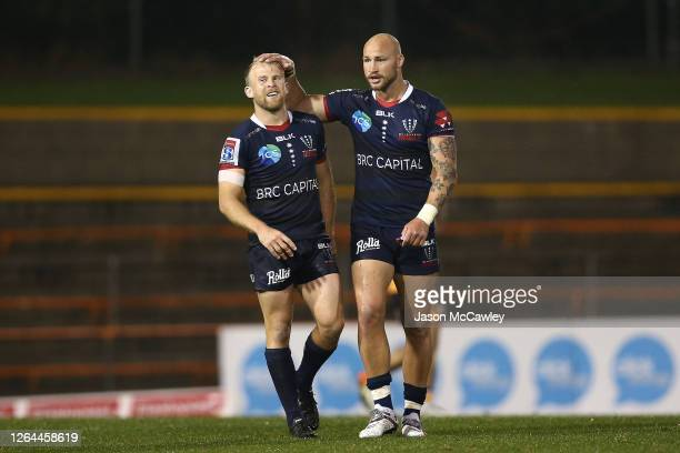 Andrew Deegan of the Rebels and Bill Meakes of the Rebels celebrate victory during the round 6 Super Rugby AU match between the Rebels and Brumbies...