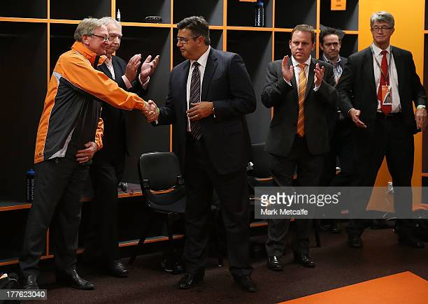 Andrew Demetriou shakes hands with Kevin Sheedy before his last match in Sydney as Head Coach of the Giants during the round 22 AFL match between the...