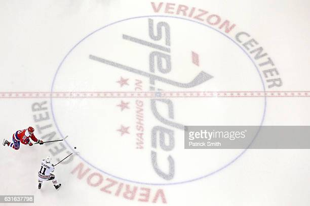 Andrew Desjardins of the Chicago Blackhawks and Lars Eller of the Washington Capitals battle for the puck at Verizon Center on January 13, 2017 in...