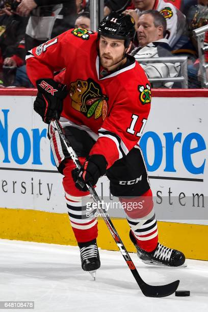 Andrew Desjardins of the Chicago Blackhawks approaches the puck in the first period against the St Louis Blues at the United Center on February 26...