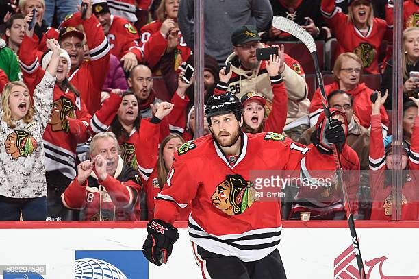 Andrew Desjardins of the Chicago Blackhawks celebrates after scoring against the Ottawa Senators in the third period of the NHL game at the United...