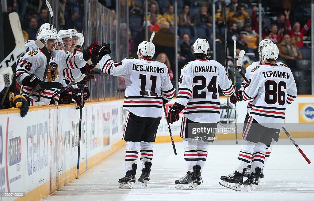 Andrew Desjardins #11 of the Chicago Blackhawks celebrates his empty net goal with the bench against the Nashville Predators during an NHL game at Bridgestone Arena on January 19, 2016 in Nashville, Tennessee.