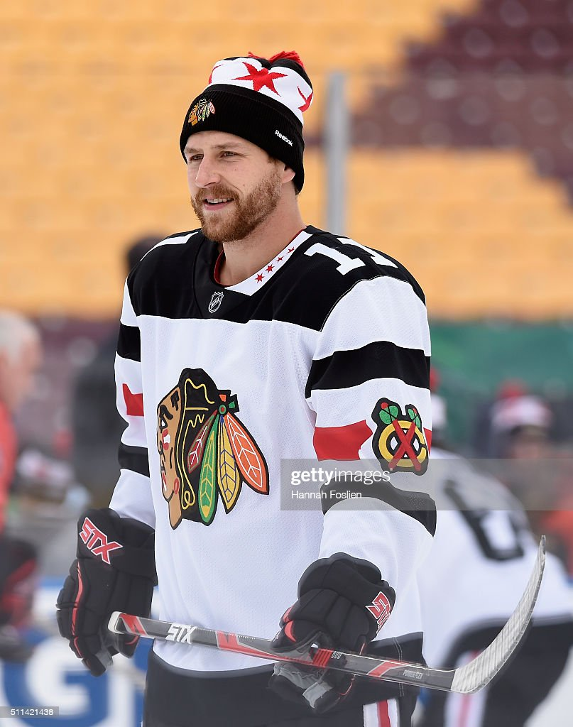 Andrew Desjardins #11 of the Chicago Blackhawks looks on during practice day at the 2016 Coors Light Stadium Series on February 20, 2016 at TCF Bank Stadium in Minneapolis, Minnesota.
