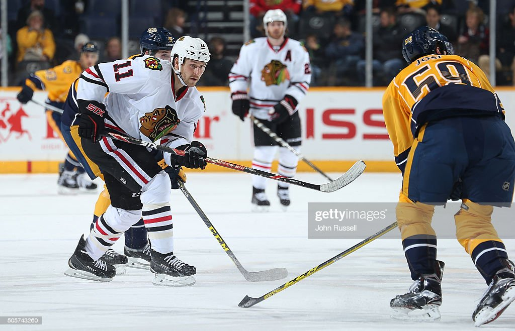Andrew Desjardins #11 of the Chicago Blackhawks scores and empty net goal against Roman Josi #59 of the Nashville Predators during an NHL game at Bridgestone Arena on January 19, 2016 in Nashville, Tennessee.