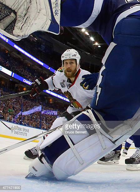 Andrew Desjardins of the Chicago Blackhawks skates in on Ben Bishop of the Tampa Bay Lightning during Game Five of the 2015 NHL Stanley Cup Final at...