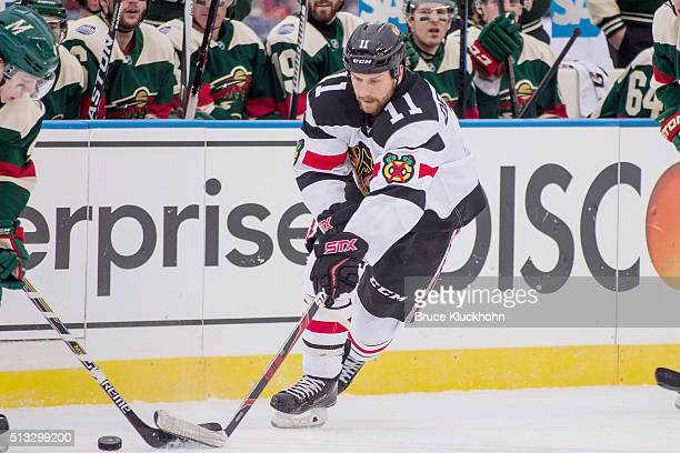 Andrew Desjardins of the Chicago Blackhawks skates to the puck against the Minnesota Wild during the 2016 Coors Light NHL Stadium Series on February...