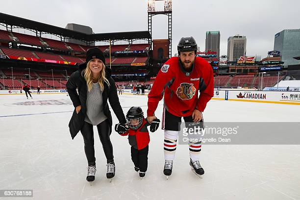 Andrew Desjardins of the Chicago Blackhawks skates with his wife Mandy and son Ames during the 2017 Bridgestone NHL Winter Classic Family Skate at...