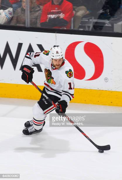 Andrew Desjardins of the Chicago Blackhawks skates with the puck against the San Jose Sharks at SAP Center on January 31 2017 in San Jose California