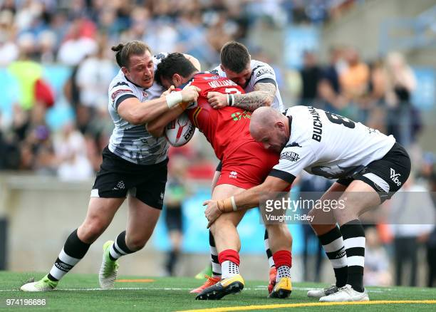 Andrew Dixon Andrew Ackers and Jack Buchanan of the Toronto Wolfpack tackle Rhys Williams of the London Broncos in the first half of a Betfred...