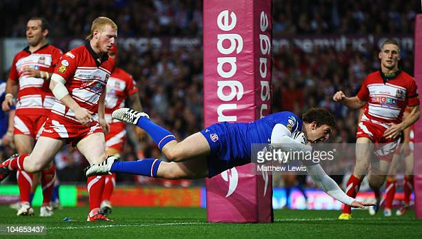 Andrew Dixon of St Helens scores a try during the engage Super League Grand Final match between St Helens and Wigan Warriors at Old Trafford on...