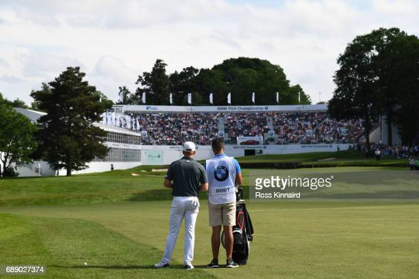Andrew Dodt of Australia and his caddie on the 18th fairway during day three of the BMW PGA Championship at Wentworth on May 27 2017 in Virginia...