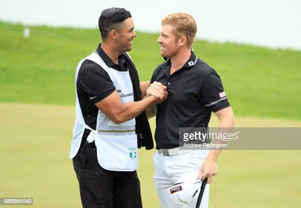 Andrew Dodt of Australia and his caddie shake hands on the 18th green during the final round on day four of the BMW PGA Championship at Wentworth on...