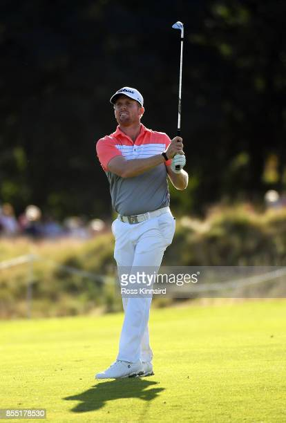 Andrew Dodt of Australia hits his second shot on the 17th green during day one of the British Masters at Close House Golf Club on September 28 2017...