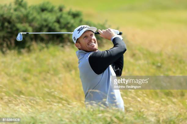 Andrew Dodt of Australia hits his second shot on the 1st hole during the final round of the AAM Scottish Open at Dundonald Links Golf Course on July...