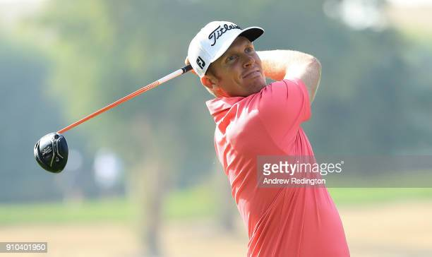 Andrew Dodt of Australia hits his tee shot on the 12th hole during round two of the Omega Dubai Desert Classic at Emirates Golf Club on January 26...