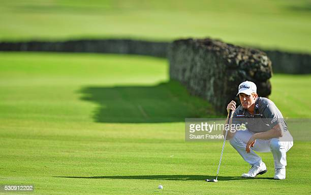 Andrew Dodt of Australia lines up a putt during the first round of AfrAsia Bank Mauritius Open at Four Seasons Golf Club Mauritius at Anahita on May...