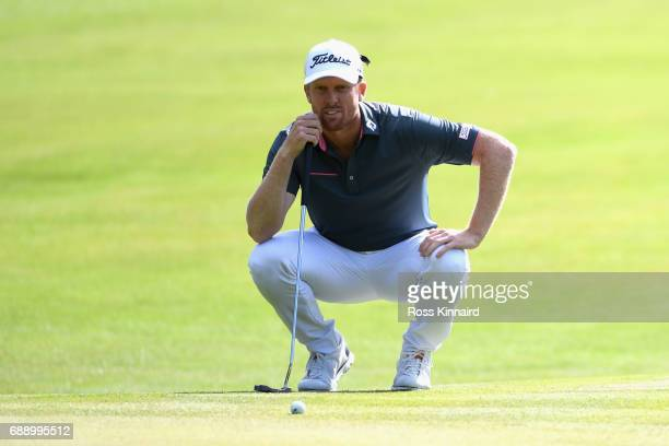 Andrew Dodt of Australia lines up a putt on 17th green during day three of the BMW PGA Championship at Wentworth on May 27 2017 in Virginia Water...