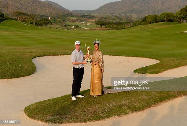 Andrew Dodt of Australia pictured with the winner's trophy and Miss Thailand World 2014 Nonthawan Thongleng during round four of the Thailand Classic...