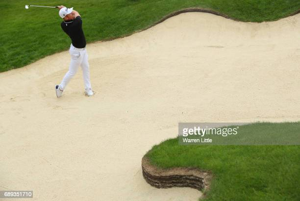 Andrew Dodt of Australia plays his second shot on the 11th hole during the final round on day four of the BMW PGA Championship at Wentworth on May 28...