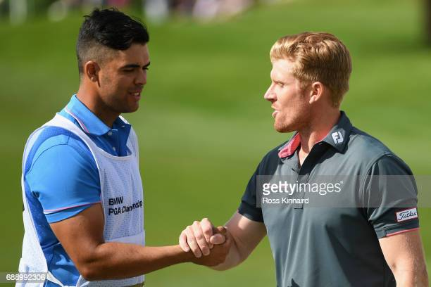 Andrew Dodt of Australia shakes hands with his caddie on the 18th green during day three of the BMW PGA Championship at Wentworth on May 27 2017 in...