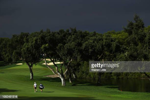 Andrew Dodt of Australia walks down the fairway after a storm stops play during day one of the Andalucia Valderrama Masters at Real Club Valderrama...