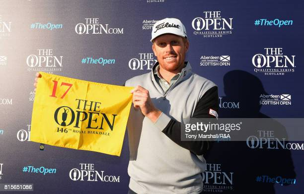 Andrew Dodt of New Zealand holds a hole flag after qualifying for The Open Championship during the Open Series Qualifying AAM Scottish Open at...