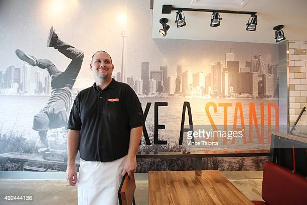 Andrew Dorich general manager of Blaze Pizza poses for pictures in the store on Dundas St E at Yonge St in Toronto
