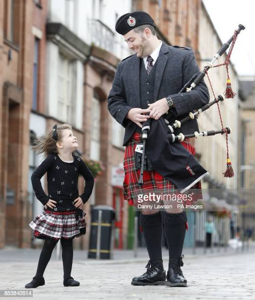 Andrew Douglas from the Stuart highlanders Pipe Band and fiveyearold Grace Carruthers launch the Piping Live Glasgow International Piping Festival...