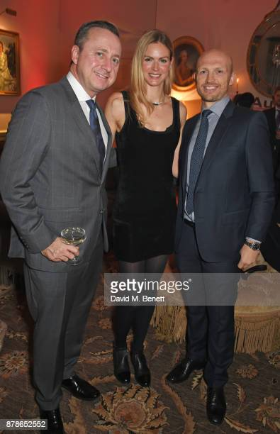 Andrew Doyle Director of Audi UK Matt Dawson and Carolin Hauskeller attend the Audi A8 Launch at Cowdray House on November 24 2017 in Midhurst England