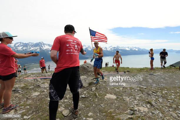 Andrew Duenow gets a drink as he passes the top of Mount Marathon during the Men's Division of the 91st Running of the Mount Marathon Race on July 4...