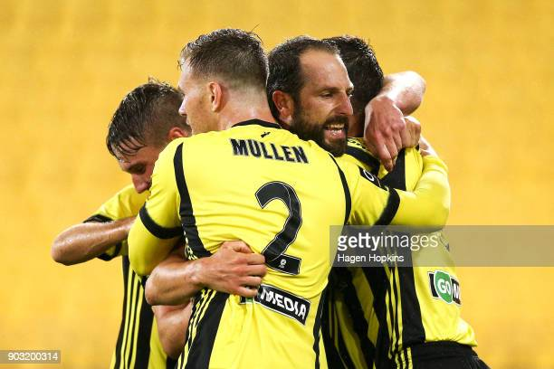Andrew Durante and Daniel Mullen of the Phoenix celebrate an own goal by Mark Milligan of the Victory during the round 15 ALeague match between the...