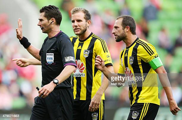 Andrew Durante and Jeremy Brockie of the Phoenix argue with referee Ben Williams after he awarded a penalty to the Heart for a foul on Harry Kewell...