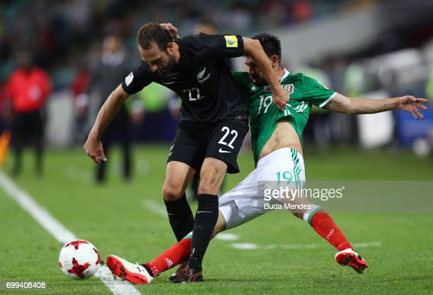 Andrew Durante of New Zealand and Oribe Peralta of Mexico battle for possession during the FIFA Confederations Cup Russia 2017 Group A match between...