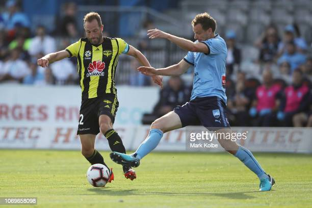 Andrew Durante of the Phoenix and Alex Wilkinson Sydney FC compete for the ball during the round seven ALeague match between Sydney FC and the...