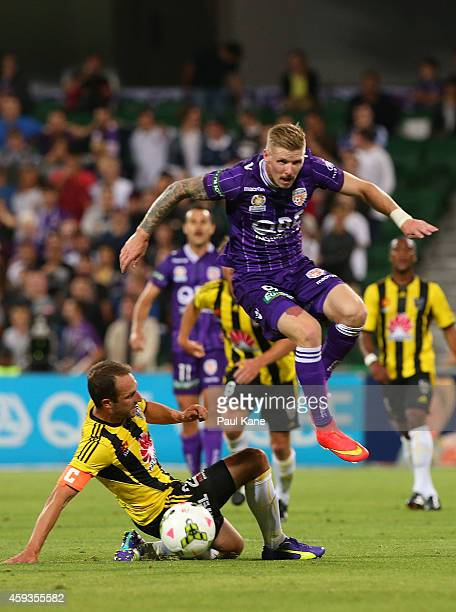 Andrew Durante of the Phoenix and Andy Keogh of the Glory challenge for the ball during the round seven ALeague match between Perth Glory and...