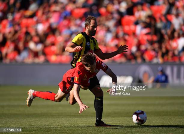 Andrew Durante of the Phoenix and Craig Goodwin of United compete for the ball during the round 11 ALeague match between Adelaide United and the...