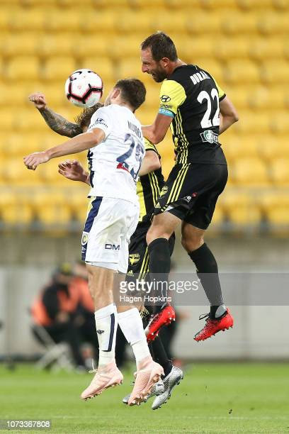Andrew Durante of the Phoenix and Jordan Murray of the Mariners compete for a header during the round eight ALeague match between the Wellington...